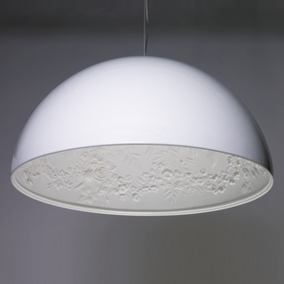 Large white dome-shaped lamp, interior with molded plaster relief decoration of floral and foliate swags. Halogen light source in center.