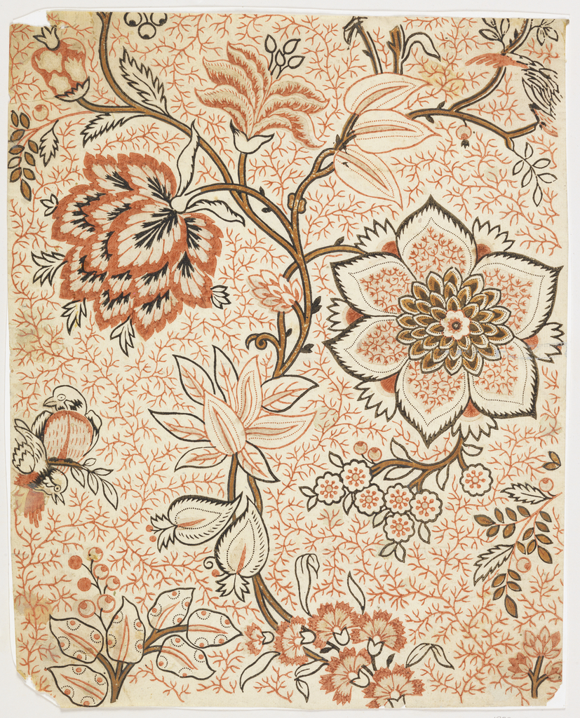 Allover floral design in orange, brown and black.