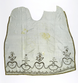 Fragment of panel of pale blue silk grosgrain with border embroidered in gold metal thread and sequins in design of stiff symmetrical flower sprays connected by a linked chain.  Gold ribbon on three edges. Lined with white linen embroidered in cotton cross-stitch, lining probably part of a skirt originally.