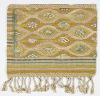 Rug sample with tangent ovoid forms in yellow, white, gray and green, with a striped border and fringe on one side.