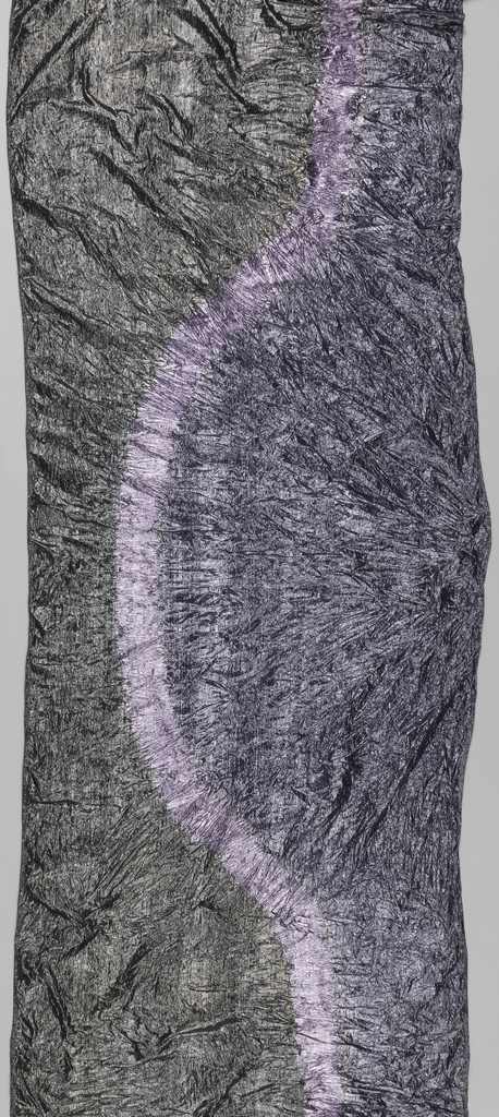 Crinkled, silver-colored fabric with an undulating purple line along its length.