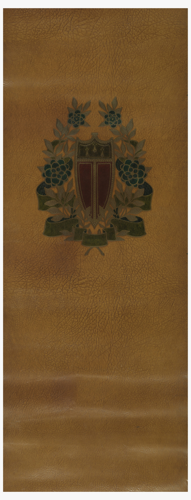 Panel of imitation leather paper with heraldic shield printed near top edge. Shield is enclosed within ribbon and floral wreath. Red and brown shield, green ribbon and blue flowers, hand-printed on brown paper embossed to resemble leather.