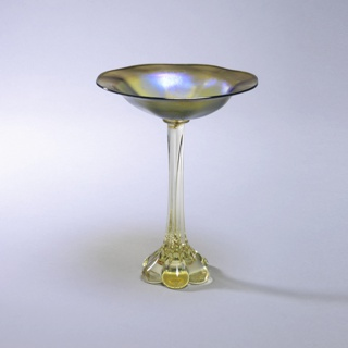 Tall footed candy dish.  Slight yellow glass foot, blue-green dish.