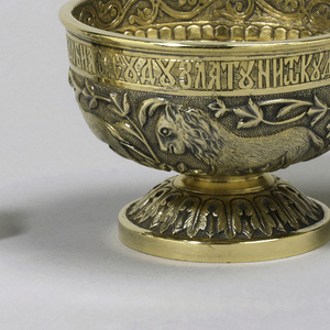 Parcel-gilt silver bratina with stand and six tcharkas, with lobed panels, each with various fantastic creatures .