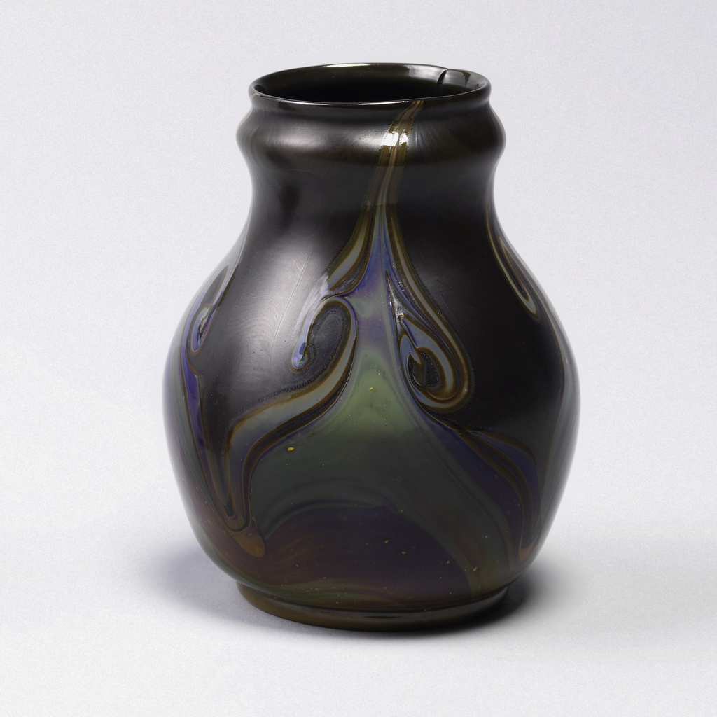 Pear-shaped body of brownish opaque glass with convex band below lip. Four multicolored marbleized flame-like patterns rising from ochre foot ring to lip.  (Note: Inherent flaw; exploded air bubble at rim of vase).
