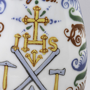 Opaque white glass with light blue cast.  Painted decoration with central bird on one side of bottle and crest on other side of bottle.