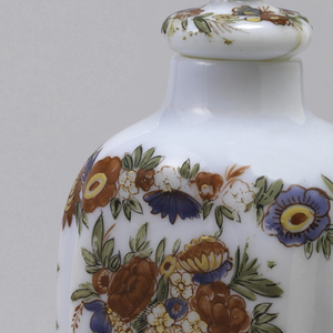 White glass bottle with painted decoration of flowers in baskets.