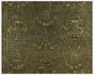 Diapered ground. Bi-symmetrical design with garlands of roses and cartouches containing musical trophies. The musical trophies alternate vertically with trophies containing arrows, bow and quiver. The ground is gold over which black is washed and rubbed off for highlights, gold ground with over wash of black.