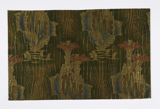 Wallpaper simulating leather. Large repeat of conventionalized poppies arranged in horizontal rows. Vertically, the poppy motifs form diagonal rows. Printed in dark green, red, blue and gold.