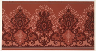 Alternating large foliate medallions connected and outlined by foliate scrolls. Small inset medallions in bottom of one medallion. Ground is dark pink. Printed in dark reds, pinks, and black. 