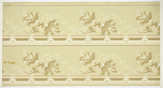 Floral and scoll border. Printed in tan and mica on tan ground. Printed two across.