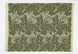 Large repeat of tulips and leaves against a background of delicate foliage, printed in green on an off-white ground.