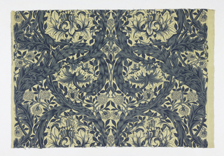 Two pieces of printed cotton with a large-scale design of curving leafy branches, interlacing to form circles enclosing flowers. In blue on an off-white ground.