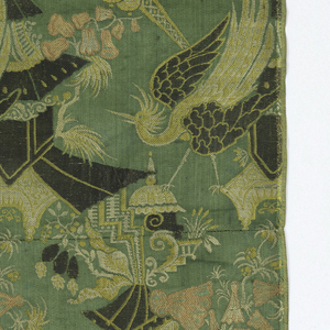 Allover design in very stylized rendering, houses, and waterall, flowers and bird in tan, gry and rose on green background