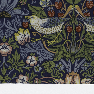 Medium scale symmetrical design with woodland flowers and strawberries with paired birds. In blue, green, yellow, orange, red and pink on a dark blue ground.