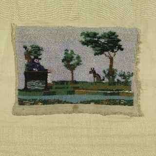 Panel of linen with colored beads sewn to form a picture of a landscape with a man sitting in a chair and a dog.
