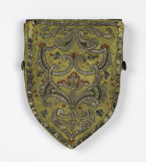 Small sheild-shaped purse of yellow silk satin damask embroidered in design of arabesques worked in silver thread with flowers in pink, blue and green silk, with the same design on both sides. Lined with pink silk and mounted on a hinged frame of engraved steel.