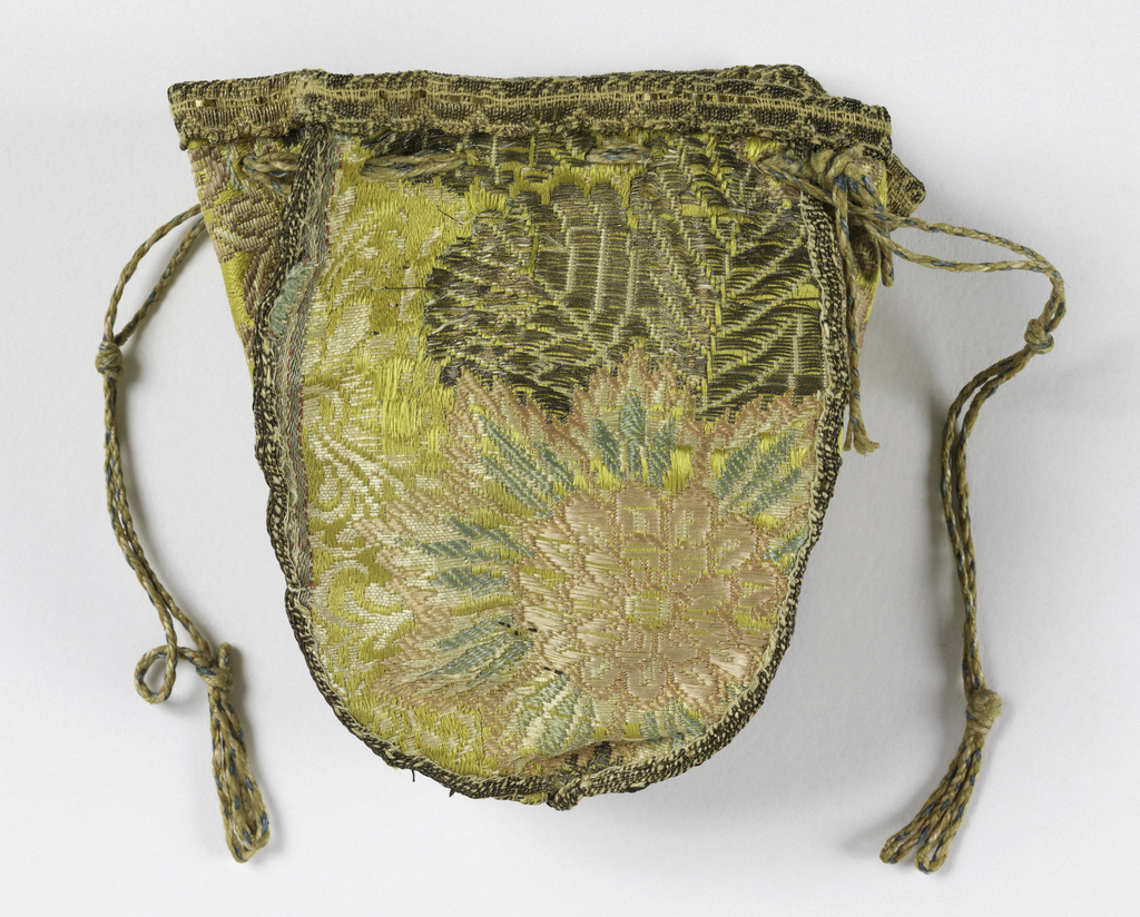 Small bag made from four sections of yellow silk brocaded with pink, green and white silk and silver metallic thread in floral desing. Bound with metal thread galoon, with drawstring at top.