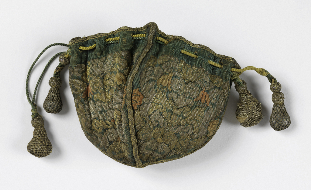 Very small green silk bag composed of four shield-shaped panels joined with very narrow gold braid and edged at the top with the same. Silk is woven with gold, silver and orange silk threads in a symmetrical floral design. Silk draw cords and drops covered with silver net. Lined with blue taffeta.