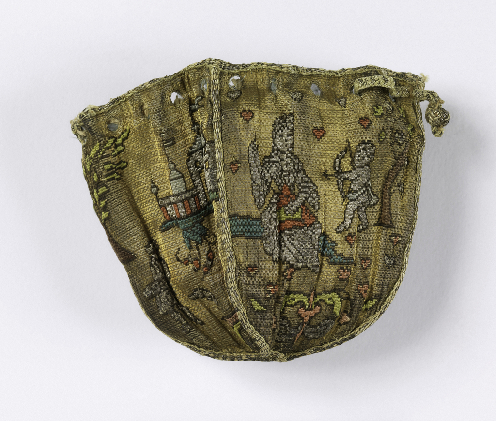 Small pouch with a small part of the drawstring remaining. Made of four rectangular pieces with a pointed curve on the bottom edge. Two panels are patterned by a landscape with a castle and two figures and a dog. The other two panels depict a seated woman sewing being shot at by Cupid. Small red hearts fill the background. Patterns have multiple colors on a gold background.