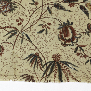 Fragment of printed cotton with a fine curving vine with scattered exotic blossoms in shades of blue, purple and red on a white ground, which is filled with very fine red branching vines.
