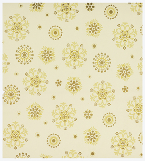 Aesthetic pattern of scattered floral motifs stylized like snowflakes or starbursts; five unique motifs of various sizes and complexity; stenciled effect; color scheme of yellow and brown on cream ground. Pattern is non-directional so would also be appropriate for ceiling use.