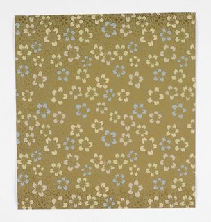 Aesthetic Japonesque all-over pattern of scattered, densely-overlapping five-petaled flowers; roughly hexagonal-shaped repeat; frequently the petals of an entire flower are picked out in blue, pale green, pale pink, or pale orange; otherwise pattern is gold.