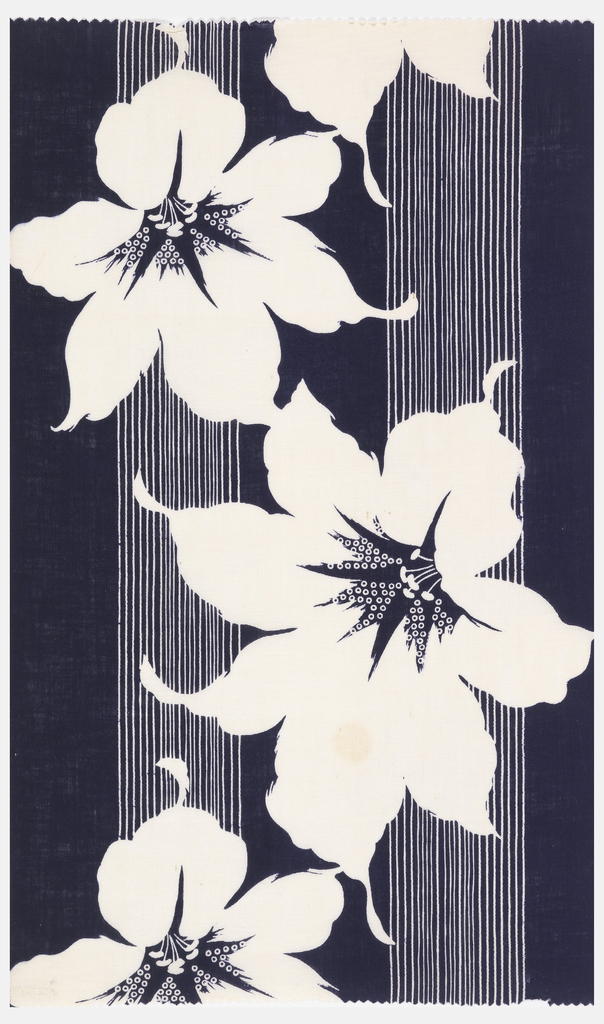 Piece of deep indigo blue cotton with design reserved in white. Large-scale design of lily heads against bands of narrow blue and white stripes.