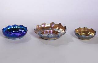 Iridescent gold. Low, curved walls with undulating rim and slight rib on each of the ten undulations. Broad, low base.