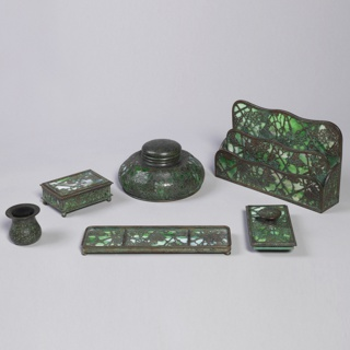 Six-piece desk set of favrille glass and bronze in a grapevine pattern.