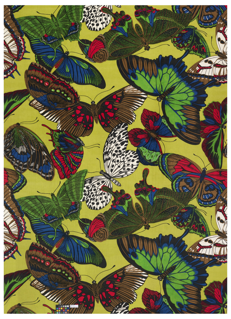 Length of cotton velvet printed with a large-scale design of naturalistic butterflies. In black, blue, green, red, and white on a yellow-green ground.