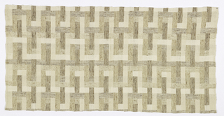 A geometric fret pattern in shades of tan, ivory, and brown.