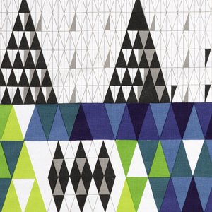Length of printed cotton with a design of wide bands of blue and white, each composed of small triangles in black, grey, light blue, yellow-green, green, blue-green, magenta, and blue with over-printing to produce additional colors.