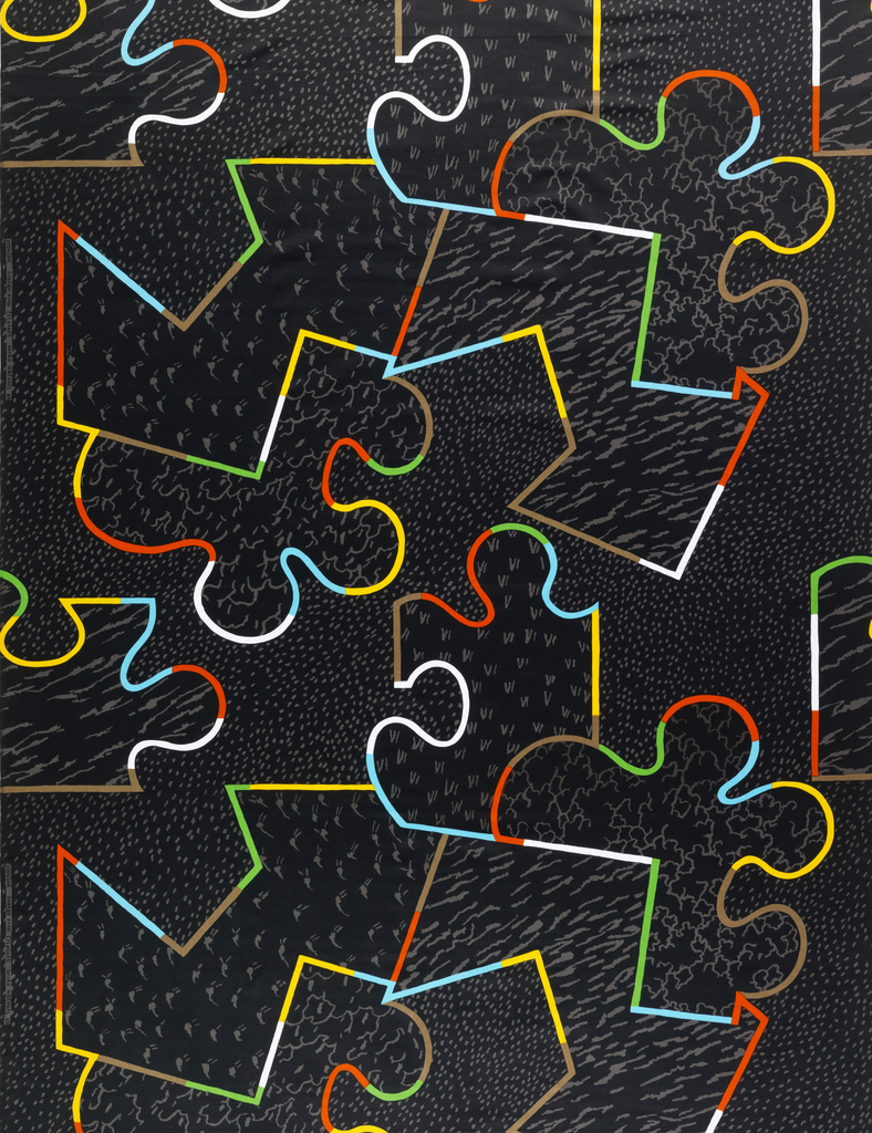 """Black """"puzzle pieces"""" each containing a different design in khaki. The of edges of the pieces are defined in bright colors: red, yellow, green, blue.The design is non- directional."""