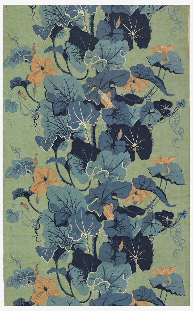 Large flowers and leaves with a large stem running up the middle of the design. Printed in pink and blues with a blue/green background on a natural color foundation fabric. At the very top of the length, some of the blues become green and just before the bottom the printing blocks stop.
