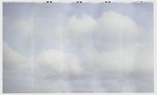 Composed of thousands of multi-color icons composed of red, yellow, blue and green bits, forming a view of white clouds in a blue sky when viewed from a distance.