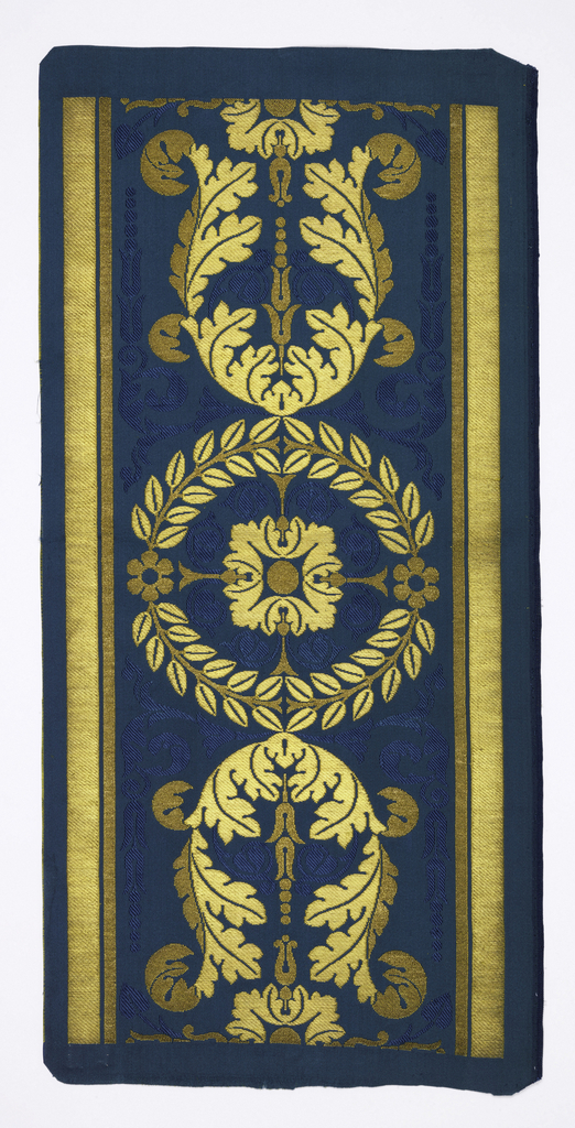 Border woven to match 1937-63-3. Neo-classical pattern of laurel wreath and acanthus leaves in the form of a lyre brocaded in gold thread on a bright blue satin ground with a monochrome figure of slender leaves; with wide and narrown gold bands top and bottom.