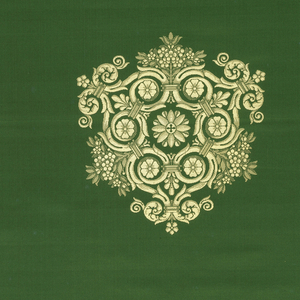 Length of woven silk satin in bright green with repeating symmetrical sheild-shaped ornament in pale yellow down the center.