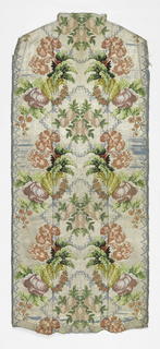 Shaped panel with a large-scale vertical turnover repeat of multicolored flowers, leaves, garlands, and shells that flank symmetrically an oversize bunch of pale strawberries. Multicolored patterning and silver-white ground brocaded on a foundation of sky blue silk gros de tours (ribbed tabby) which shows through as an elaborate lobed outline.