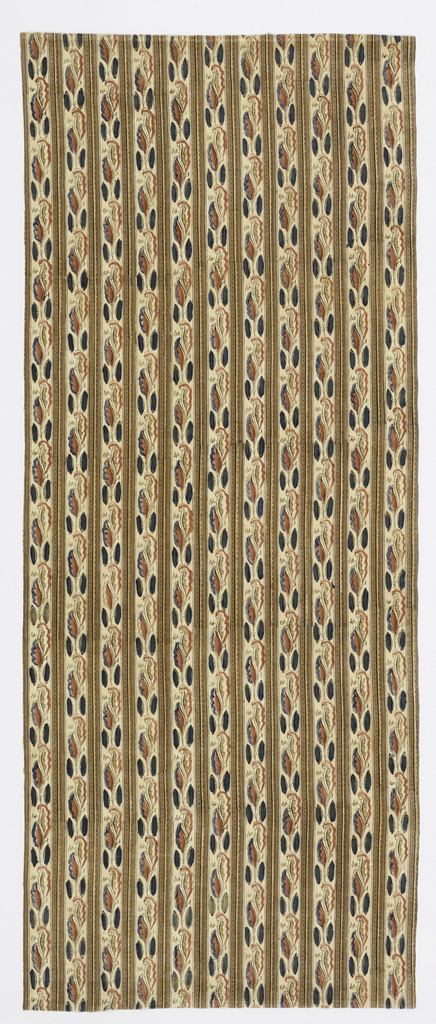 Length of printed cotton with vertical stripes of tan and yellow alternating with stripes curved leaves in red and blue on a white ground.