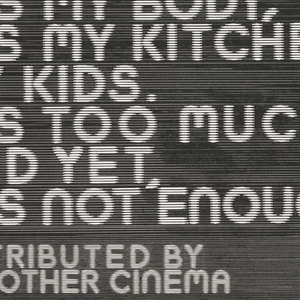 """On black background lined like an electronic monitor, the text: """"Number Two x // A Film by Jean-Luc Godard."""" Followed by a photograph of a woman's face in lower right. Inscription: """"It's my body, it's my kitchen, my kids. It's too much, and yet, it's not enough"""", lower left; """"Distributed by The Other Cinema"""", bottom left."""