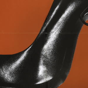 """On red background, a photograph of a polished black high-heeled shoe, the heel in the shape of a handgun, and framed by the inscription """"TACONES"""" at top, and 'LEJANOS"""" at bottom. At the very top is written: """"EL DESEO S.A. PRESENTA UN FILM DE PEDRO ALMODOVAR"""", and at bottom are the credits: """"VICTORIA ABRIL  MARISA PAREDES  MIGUEL BOSE"""" followed by further credits in smaller type."""
