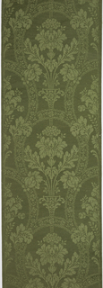 Green texture print imitating damask: formalized stiff flowers separated by lacy bands. Straight repeat and match.
