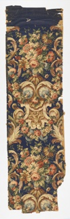 On dark blue ground, large scale scrollwork of acanthus, shells, and straps in tones of beige, gray, pink, brown and green with blue bosses and drapery and pink flowers, green foliage. All in heavily applied, grayed, shaded colors.