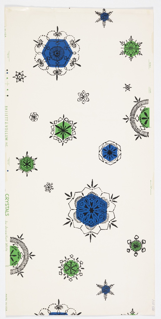 Assortment of large and small widely spaced crystals or snowflakes outlined in black. Some are colored green or blue. Printed on white ground.