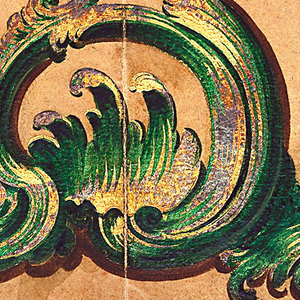 Almost symmetrical rocaille motif in green, brown, and gold on tan background.  The pattern is of a swirling, looping designs with wave-like detailing.  The materials drawn for this panel appear to be simililar to jade, bronze, silver, and gold.