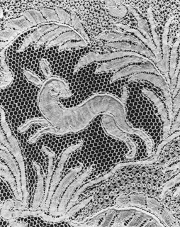 Cravat end of Brussels-style lace with a hunter on horseback in the center, surrounded by fantastic foliage, trees and flowers, birds, a rabbit, a deer, and other animals. A figure with a spear blowing a horn in the lower right corner, and two figures carrying birds? in the upper left.