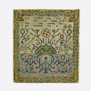 "Four cross borders; one containing verse; two showing floral patterns and squirrels; the inscription ""Sarah Cook, her sampler 1744"" surrounded by angular floral border with stags in the corners."