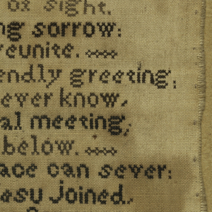 "Two verses, one entitled ""Friend Farewell,"" and the initials ""P.G.""  Worked in cross stitch."