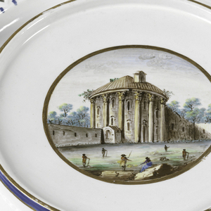 Plate with pierced lattice rim and polychromed scene of Roman ruins in center.